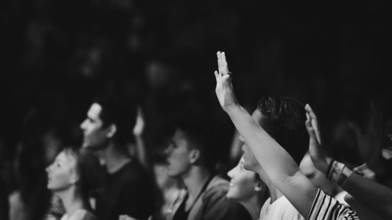Hand lifted during worship at Presence Conference