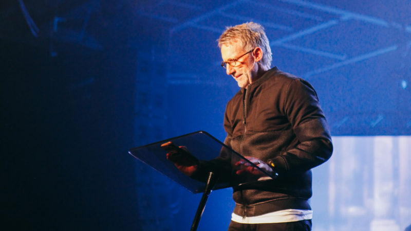 16x9 Ps Phil reading from his iPhone while preaching at Presence Conference 2016