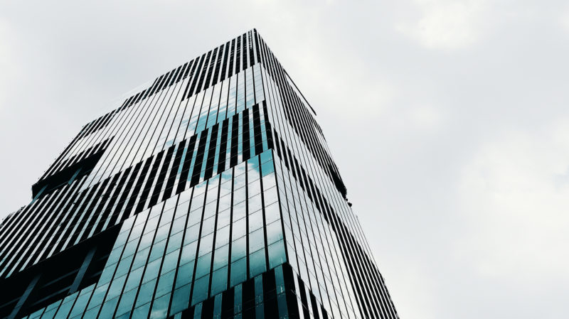 High rise building with grey sky in the background