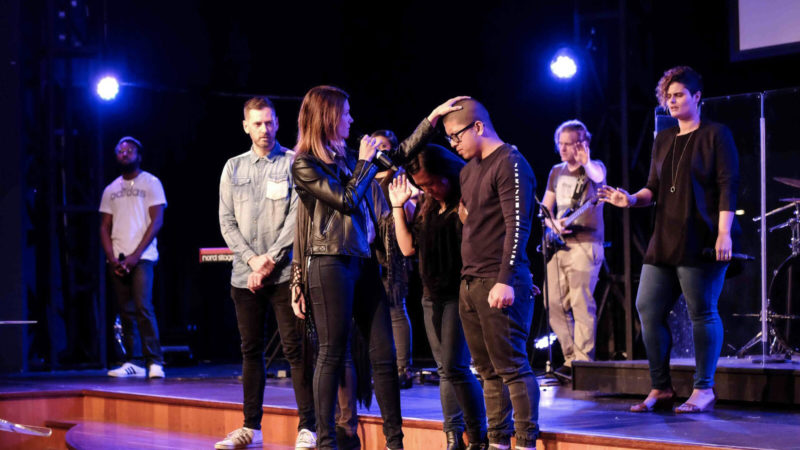 Ps Natalie Taylor prays for couples at C3 Church Silverwater