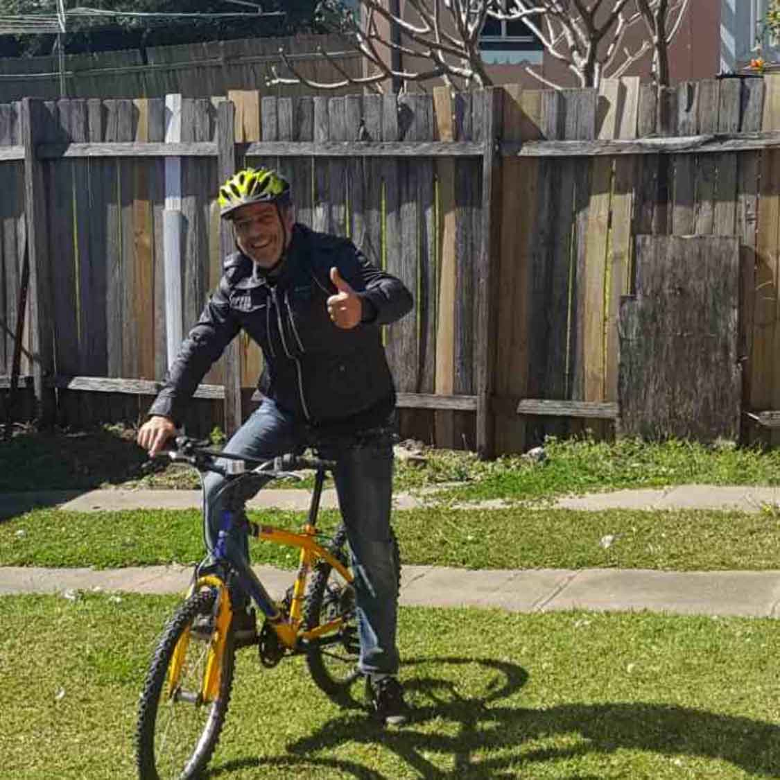 Sam's Bikes Recipient who now rides his bike to work.